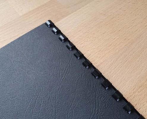 Rückseite Kunststoff-Spiralbindung im Copyshop